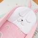 Detalle cojín conejo orejas rosas para capazo