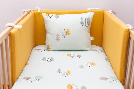 Protectores de cuna para bebé en color amarillo a juego con sábanas de motivos naturaleza